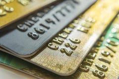 Gold and platinum credit cards close up stock photos