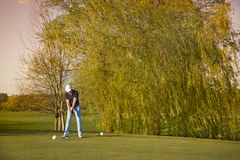 Gold player teeing-off. Royalty Free Stock Photos