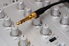 Gold plug on dj music mixer Stock Photo