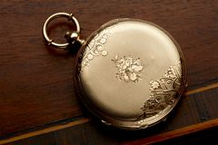 Gold pocket watch royalty free stock photos