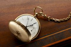 Gold pocket watch Stock Photography