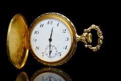 Gold pocket watch on a black background Royalty Free Stock Images