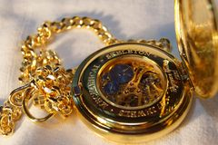 Gold pocket watch with chain Stock Images