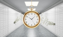 A gold pocket watch on the chain in a room with safe deposit boxes and dollar notes are flying out from one box. A concept of stor Stock Photos
