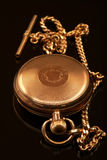 Gold pocket watch and chain Royalty Free Stock Photography