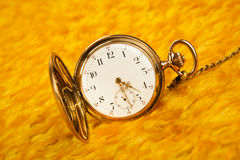 Gold pocket watch on gold cover. Gold pocket watch on on gold cover close-up Stock Photo