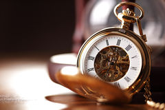 Gold pocket watch and hourglass. Vintage pocket watch and hour glass or sand timer, symbols of time with copy space Royalty Free Stock Images