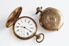 Gold pocket watch isolated Royalty Free Stock Image