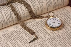 Gold Pocket Watch On Old Bible Stock Images