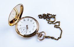 Gold pocket watch on white. Background close-up Royalty Free Stock Photos
