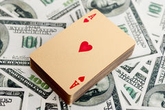 Gold poker cards Royalty Free Stock Image
