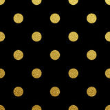 Gold polka dot seamless pattern on black background Royalty Free Stock Images