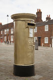 Gold Post Box Stock Image