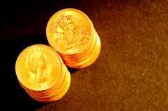 Gold  pounds Stock Photos