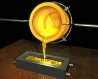 Gold pour. Pouring gold from a crucible into a mould Stock Photo
