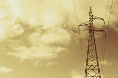 Gold Power Lines. High voltage power lines in gold tone Royalty Free Stock Photography