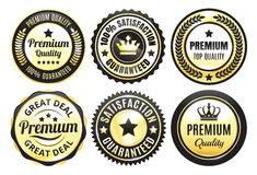 Gold Premium Quality badges. Variations of gold and black premium or top quality badges or seals on white Stock Images
