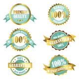 Gold premium quality guarantee labels. Set of gold and turquoise premium and quality labels/badges/emblems. Can be used for product and service labelling Royalty Free Stock Images