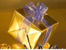 Gold present with blue ribbons Stock Photo
