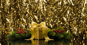 Gold present and Christmas tree branches Stock Photos