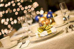 Gold present on dining table Stock Photography
