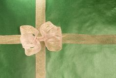Gold Present on Green Paper Royalty Free Stock Image