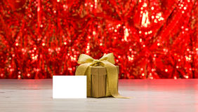 Gold present with place card Royalty Free Stock Images