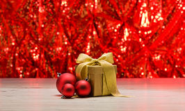 Gold present with red bauble Stock Photos