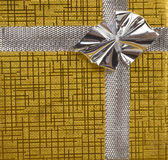 Gold present with silver bow Stock Photo