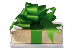 Gold present wrapped with green ribbons Royalty Free Stock Photos