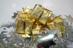 Gold Presents 2. Gold presents wait for a recipient to open them Royalty Free Stock Image