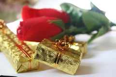 Gold presents 3. Gold presents and silk roses Royalty Free Stock Photos
