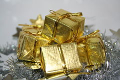 Gold Presents. Stacked for gifts to a loved one Royalty Free Stock Photography