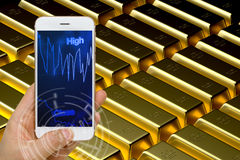 Gold Price Trading Concept Using Smartphone or Smart Device to M. Concept of using smartphone or smart device to monitor real time fluctuation of gold price in Royalty Free Stock Photography
