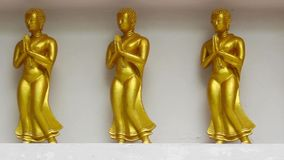 Gold priest statue in Thailand temple stock footage