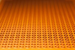 Gold Prototype PCB Board abstract background. Close up Stock Image