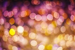 Gold and purple abstract bokeh background glittering stars for c. Hristmas and new year event Royalty Free Stock Images