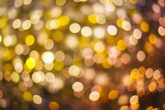 Gold and purple abstract bokeh or defocused background glitterin Stock Photos