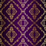 Gold-on-Purple seamless swirly Indian pattern Stock Photo