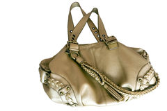 Gold purse. Luxurious and exquisite, made of leather, colored in gold Stock Images
