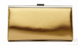 Gold purse on a white background Royalty Free Stock Photo