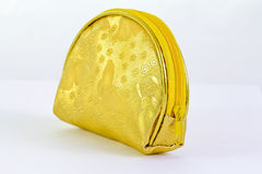 Gold purse on white background Stock Images