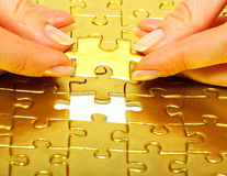 Gold puzzle Royalty Free Stock Photos