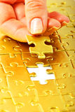 Gold puzzle Stock Images