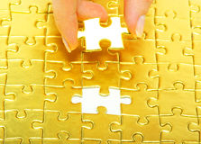 Gold puzzle Stock Photo