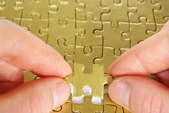 Gold puzzle royalty free stock image