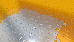 Gold Puzzle Pieces on all other the floor becoming Silver pieces. Some Gold Puzzle Pieces on all other the floor becoming Silver pieces Stock Photos