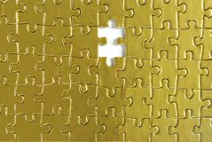 Gold puzzles Royalty Free Stock Photos
