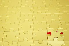 Gold puzzles. For background. business concept Royalty Free Stock Photography