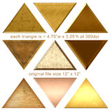 9 Gold Pyramids Triangle Shapes. Gold pyramid structures, shapes about 4.75 w x 3.25 h at 300dpi original file size 12 x 12.  3 rows of 3 golden triangles Stock Image